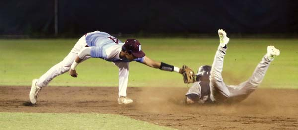 The Bears' Kaipo Haole tags out Jace Baqui on a steal attempt in the second.  The Maui News / CHRIS SUGIDONO photo