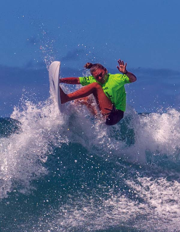King Kekaulike High School's Kayla McCarthy heads to a shortboard win in Saturday's season-opening Maui Interscholastic League surf contest at D.T. Fleming Beach Park. -- 1morephotography.com / DAYANIDHI DAS photo