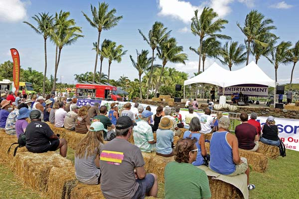 Spectators kick back on bales of hay and watch the Live Chefs Challenge at last year's Maui County Agricultural Festival at Maui Tropical Plantation in Waikapu. This year's event will be held from 9 a.m. to 4:30 p.m. on Saturday, April 1. -- Maui County Agricultural Festival photo