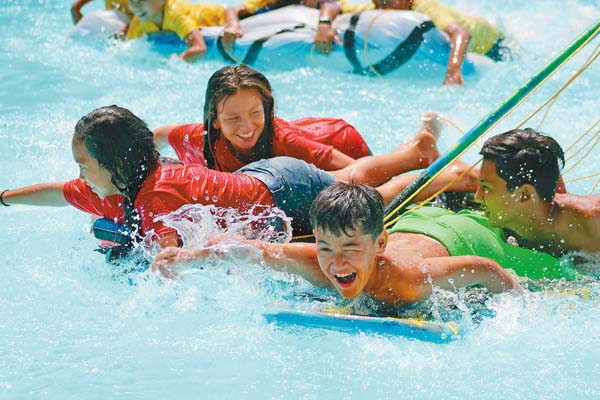 Red Team members furiously paddle their way to victory Sunday in the Camp Maluhia pool. They were among 112 children attending Camp Pilialoha O Maui, a program for kids whose parent or parents are incarcerated. The Maui News / COLLEEN UECHI photo