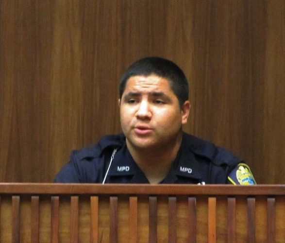 Wailuku patrol officer Michael Meredith, testifying Monday in Wailuku District Court, describes being pinned against the wall by a stolen car in the McDonald's drive-thru in Wailuku on March 6. The Maui News / LILA FUJIMOTO photo