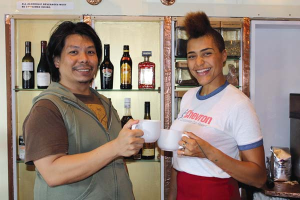 Da Vine Art baristas Kaze Garcia (left) and Gaia Golden toast to the new concept with a cuppa or two. The wine and coffee bar is across the street from Charley's and will expand its hours soon. The Maui News / CARLA TRACY photo