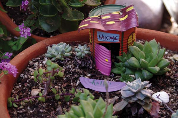 A fairy garden made by Victoria Hannley in Tuscon, Ariz., features objects left over from her daughter's birthday party and an empty tin soup can. -- Victoria Hannley photo via AP