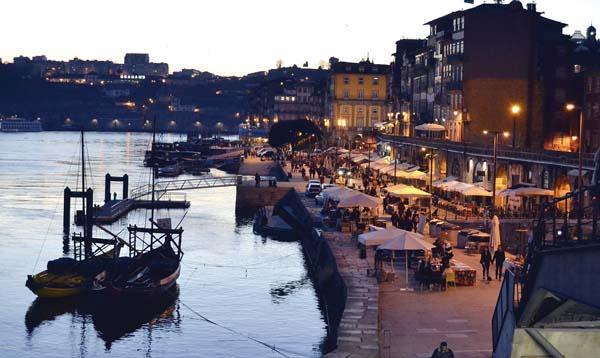 The waterfront Ribeira district along the Douro River in Porto, Portugal. The river separates Porto from Vila Nova de Gaia, where the famous port wine caves are located. -- Albert Stumm photo via AP