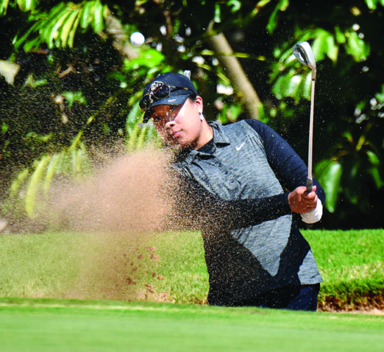 Colorado's Brittany Fan, a graduate of Kamehameha Schools Kapalama, blasts from a bunker on the ninth hole of the Kapalua Bay Course during Tuesday's second round of the Anuenue Spring Break Classic.  • The Maui News / MATTHEW THAYER photo
