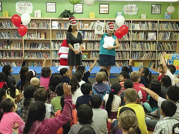 Leah Belmonte, representative for Hawaii first lady Dawn Ige, and Patty Hemmen of the Rotary Club of Kihei Wailea share information about Rotary prior to reading aloud from Dr. Seuss books at Kihei Elementary School.