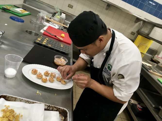 Culinary Arts student Jason Agbayani plates food as practice for the Famous Festivals event. •  Photo courtesy UH-Maui College