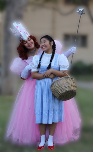 """Glinda the Goodwitch (Danyelle Contreras) and Dorothy (Erin Tsue) discuss how to get back to Kansas as Baldwin High School Performing Arts Learning Center and BaldwinTheatre Guild present """"The Wizard of Oz."""" Performances are at 7 p.m. Thursdays through Saturdays and 2 p.m. Sundays beginning tonight through April 16 in the auditorium at the Baldwin High School campus. There will be no performance on April 8; there will be an additional 2 p.m. performance on April 15. Tickets are $12 for adults; $10 for seniors; $7 for students 12 to 17; and $5 for children 11 and younger, and are available at the box office 45 minutes before showtime. • Ray-Anne Dela Cruz photo"""
