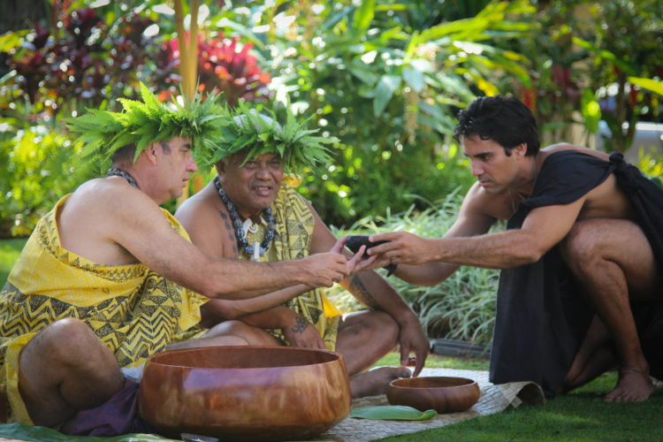 Native Hawaiian cultural practitioners Lopaka Aiwohi (from left), The Ritz-Carlton, Kapalua Cultural Advisor Clifford Nae'ole and Kainoa Horcajo partake in an awa ceremony.  • The Ritz-Carlton, Kapalua photo