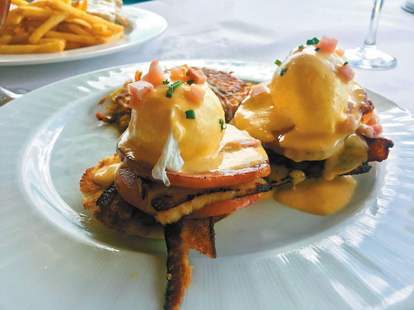 """""""The Club"""" eggs Benedict is topped with smoked bacon, turkey, Canadian bacon and vine ripe tomatoes at Sarento's on the Beach's new Brunch Every Day from 7 a.m. to 3 p.m. in its oceanfront spot in Kihei. Photo courtesy Sarento's on the Beach"""