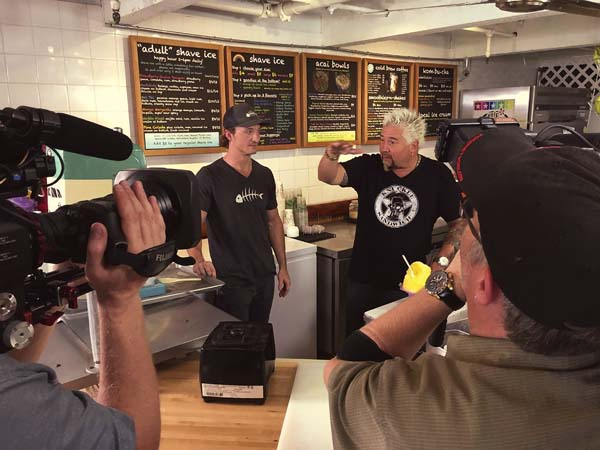 """Chef and co-owner Julian Bonfardin (left) listens to Food Network host Guy Fieri during filming of """"Diners, Drive-ins and Dives"""" at Down the Hatch in Lahaina earlier this month. Childhood friends Bonfardin, Javier Barberi and Dave Fincher started the restaurant in 2015. Down the Hatch photo"""