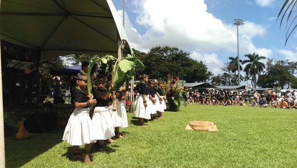Children from Halau Na Kaulakuhikuhi hold taro plants at an earlier East Maui Taro Festival.