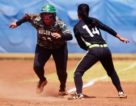 Molokai High School's Brooke Keliihoomalu heads home after a throw gets by Lanai's Gina Anton in the second inning of the Farmers' 13-6 win over the Pine Lasses in Saturday's Maui Interscholastic League Division II tournament final at Patsy Mink Field. -- The Maui News / CHRIS SUGIDONO photo
