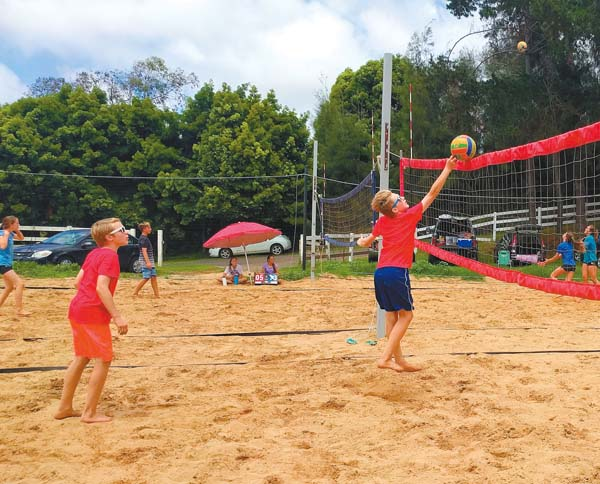 Thomas Russell sends a shot over the net as Tyler Russell looks on during an Aloha Volleyball Middle School Scholastic Tournament match Sunday in Kula. SCOTTIE ZUCCO photo