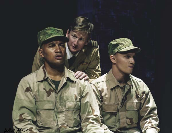 """Reuben Carrion (from left), Ricky Jones and David Tuttle put military mentality and the Marine code of honor on trial at the Maui premiere of Aaron Sorkin's """"A Few Good Men."""" Performances are 7:30 p.m. Fridays and Saturdays, and 3 p.m. Sundays, April 28 through May 14 at the Historic Iao Theater in Wailuku. Tickets range from $20 to $40. Call 242-6969 or order online at www.mauionstage.com. Brett Wulfson photo"""