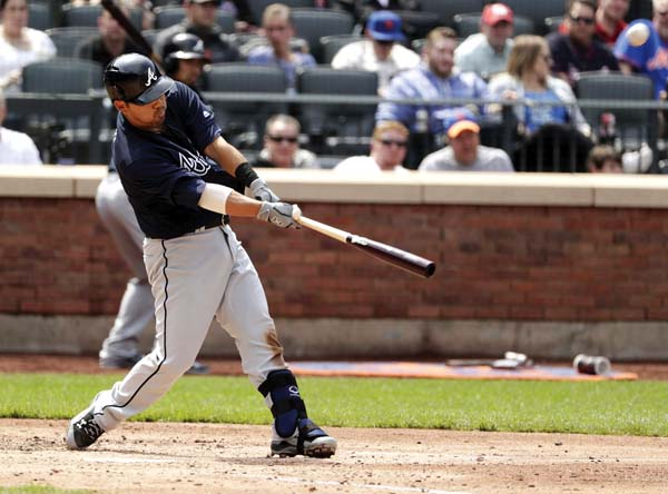 The Braves' Kurt Suzuki hits a three-run homer during the fifth inning Thursday. AP photo