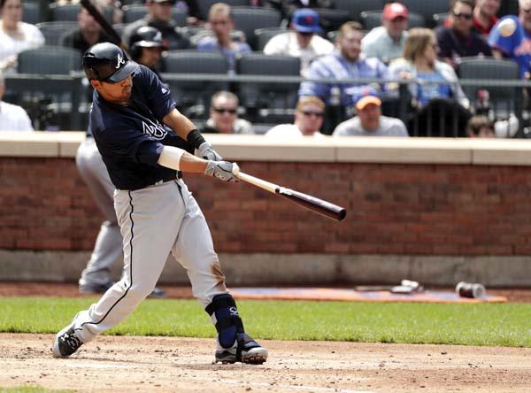 The Braves' Kurt Suzuki hits a three-run homer during the fifth inning Thursday. AP photo