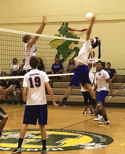 Kalan Birnie of Seabury Hall tries to get a ball past Molokai's Kar- ter Kester during the Spartans' 25-17, 25-19, 21-25, 22-25, 16-14 win over the Farmers on Friday. -- KAGI MOEA'I photo
