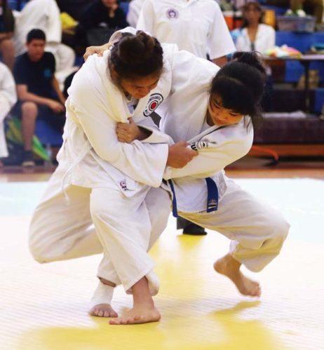 King Kekaulike's Alyssa Fusato takes on Kamehameha Maui's Ashlee Palimoo on Saturday. -- The Maui News / CHRIS SUGIDONO photo