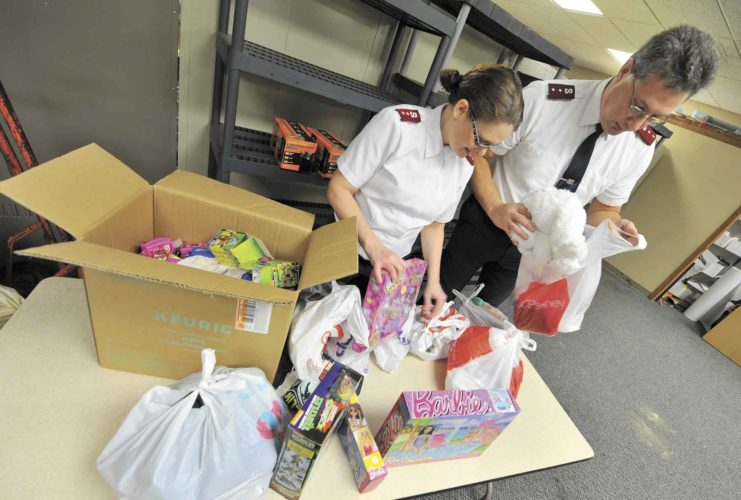 -Messenger photo  by Hans Madsen Salvation Army Captains Melody and Rick Hamelund look through some of the toys donated for this year's Angel Tree program at the Fort Dodge Corps Community Center. Rick Hamelund said that they are in need of volunteers for the annual Red Kettle Campaign, which is behind on its $60,000 goal.