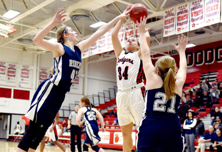 Messenger photo by Britt Kudla  Liza Van Zyl of Fort Dodge scores against Des Moines Roosevelt in the Dodger gym.
