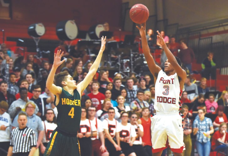 -Messenger photo by Britt Kudla Trey Mosley of Fort Dodge shoots over Hoover's Jontay Collins on Tuesday