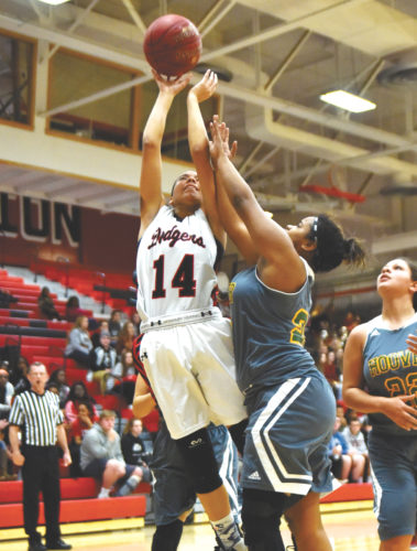 -Messenger photo by Britt Kudla Justice Crooks of Fort Dodge shoots around Hoover's Kassandra Claytor on Tuesday