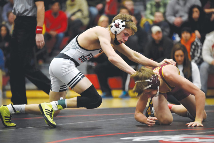 -Messenger photo by Britt Kudla Jeremy Ayala of Fort Dodge wrestles against Ankeny's Derek Anderson on Thursday