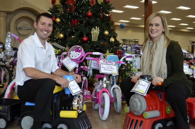 -Messenger photo by Chad Thompson  Matt Johnson, general manager of Fort Dodge Ford Lincoln Toyota, left, and Abigail Johnson, digital relations manager, pose next to bikes in the showroom in Fort Dodge recently. The bikes will be donated to kids in Webster, Wright, Hamilton and Humboldt counties for Christmas.