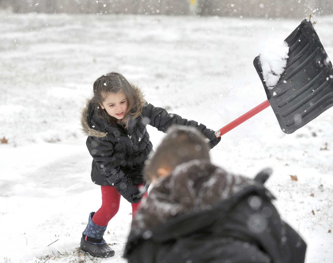 -Messenger photo by Hans Madsen  Mara Zuspann, 4, of Fort Dodge, tries her hand at shoveling snow in the 500 block of North 18th Street Saturday morning as the first major snow of the season fell in Fort Dodge. She quickly decided the shovel was too big.