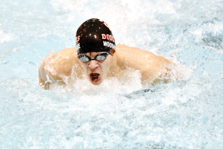Messenger photo by Britt Kudla  Trent Woodhouse of Fort Dodge swims during the 200 medley relay against Johnston on Thursday in the Dodger pool. For more photos, please visit CU.messengernews.net