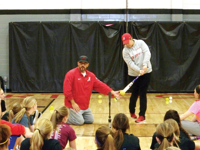 Messenger photo by Eric Pratt  Alabama softball coach Patrick Murphy teaches campers a drill with former Crimson Tide player Jadyn Spencer on Tuesday in the Fort Dodge Senior High gym. Murphy is a national championship coach originally from Waterloo; Spencer is a former Waterloo West all-state standout.