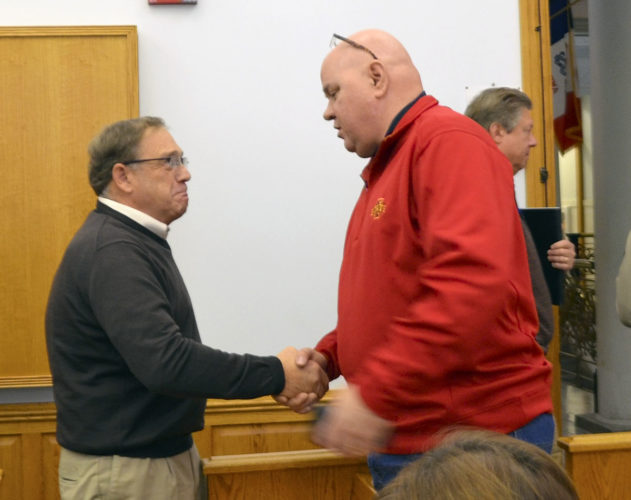 -Messenger photo by Joe Sutter  Webster County Supervisor Bob Singer, left, shakes hands with Bob Thode, who will replace him on the board next year, at his last meeting Tuesday.