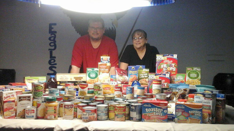 The Fort Dodge Eagles Club sponsored a food drive for the Lord's Cupboard. Aerie President Mark Christnagel and Auxiliary President Joann Hoft are pictured with the donated items.