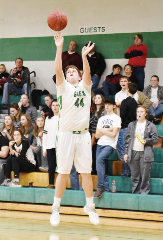 -Messenger photo by Britt Kudla Charlie Doyle of St. Edmond shoots a three point against Hampton-Dumont on Friday