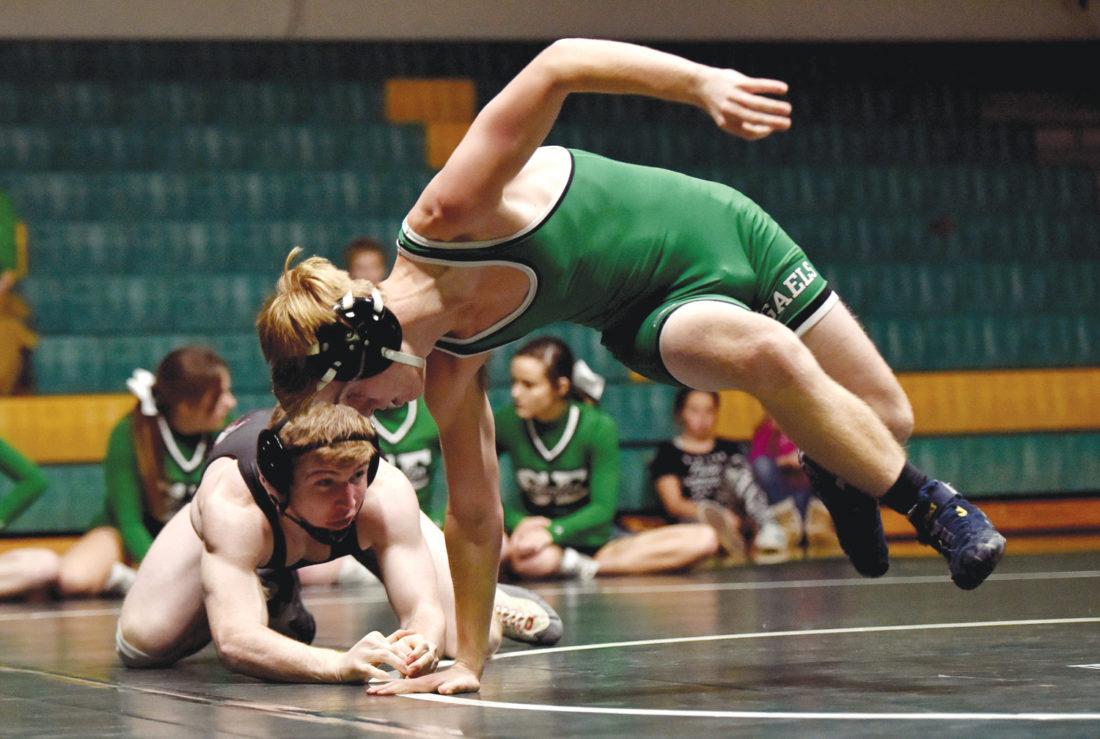 -Messenger photo by Britt Kudla Cole Allison of St. Edmond wrestles against Clarion-Goldfield/Dows Tanner Abbas on Thursday