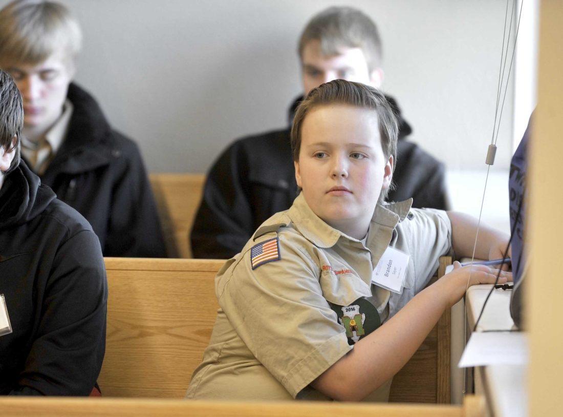 -Messenger photo by Hans Madsen  Boy Scout Brandon Sayer, 13, of Fort Dodge, a member of Troop 7, takes notes after Saturday morning Magistrate Court. The Scouts were there to learn about how the court system works for their Law Merit Badge.