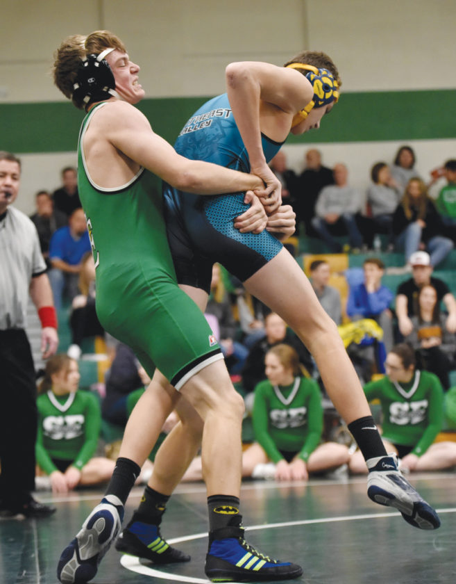 -Messenger photo by Britt Kudla Ty Smith of St. Edmond wrestles against Southeast Valley's Carter Fluckiger during Gaels Invitational on Saturday
