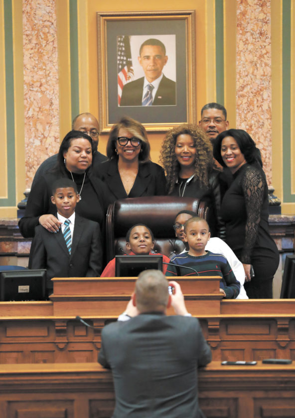 -AP photo  Rep. Helen Miller, D-Fort Dodge, center, poses for a photo with family members during the opening day of the Iowa Legislature Monday at the Statehouse in Des Moines.