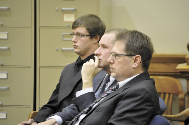 -Messenger photo by Chad Thompson  Colten Bills, 21, of Dayton, left, listens as Chief District Judge Kurt Wilke prepares to announce his verdict in Webster County District Court Monday afternoon. Bills' attorneys, Derek Johnson, center, and Charles Kenville, right, listen with him.
