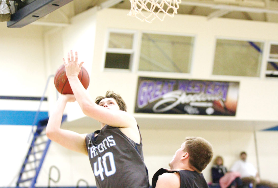 Photo by Paul DeCoursey  Noah Stukey drives for Iowa Central against the Waldorf JV inside Hodges Fieldhouse on Monday.