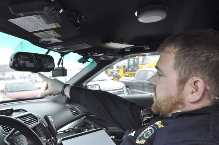 -Messenger photo by Peter Kaspari  Gowrie Police Chief Patrick Monaghan demonstrates how the new dashboard camera system works in his patrol vehicle. The camera system, which included a body camera, was partially funded by Webster County Crime Stoppers.