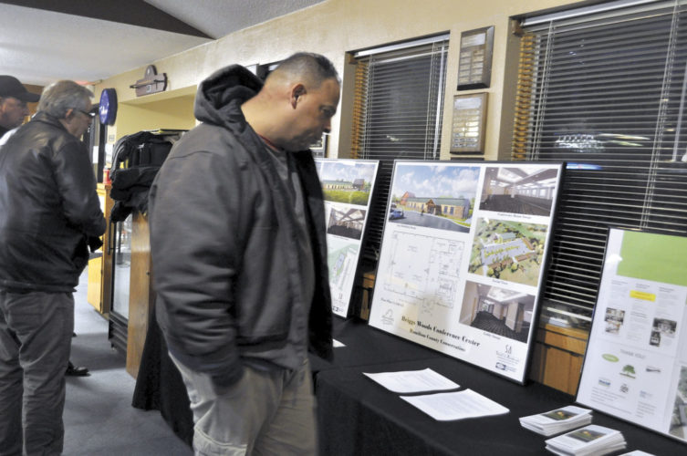 -Messenger photo by Adri Sietstra  The event Wednesday gave people the opportunity to see illustrations of the proposed Briggs Woods Conference Center.