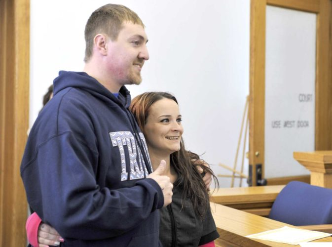 -Messenger photo by Peter Kaspari  Chase Behrends, of Fort Dodge, gives a thumbs up as he poses for a photo with his fiancee, Sharay Benge, of Des Moines. Behrends graduated from Webster County Drug Treatment Court on Friday. He said the court helped him turn his life around.