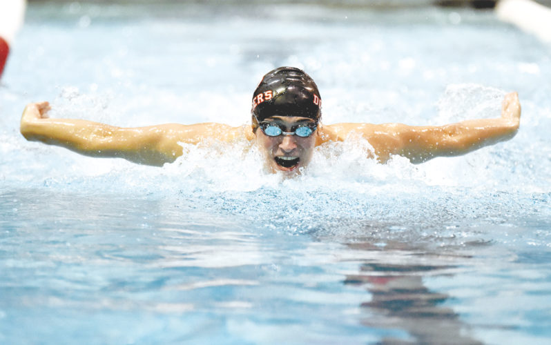 -Messenger photo by Britt Kudla Mitchell Emery of Fort Dodge competes against Ames during the men 100 yard Butterfly on Tuesday inside Dodgers pool