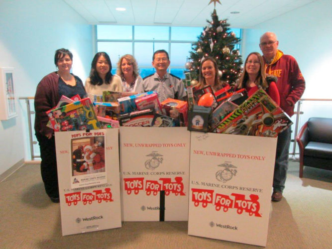 CJ Bio America donated four boxes of toys and raised $370 for Toys for Tots. Pictured from left are Patty Villa, Sofia Wu, Brenda Benton, JT Nam, Heather Farrell, Becca Long and Greg McDermott.
