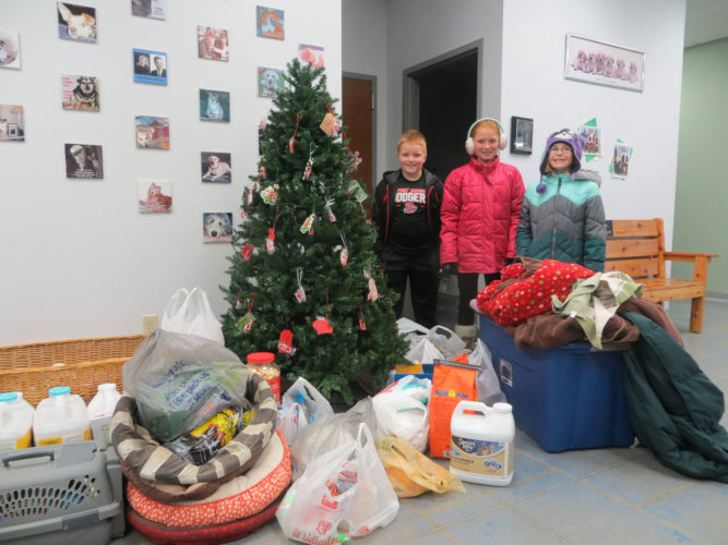 The Fort Dodge Community School District collected donations for Almost Home as a chain reaction of kindness for Rachel's Challenge. Two vans full of supplies were dropped off to the shelter. Shown from left are Gavin Pederson, Ashlyn Wills and Ella Champagne from Cooper Elementary.