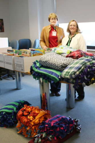 St. Edmond second-grade teacher Candi Streit organized a project to make tied fleece blankets for kids at Blank Children's Hospital in Des Moines. Each elementary classroom tied a blanket for the hospital . Each blanket will include a prayer for the recipient.  Students have also been collecting gently used or new books to be sent as a part of their donation to the children.   Pictured are St. Edmond Principal Linda Mitchell and Streit.