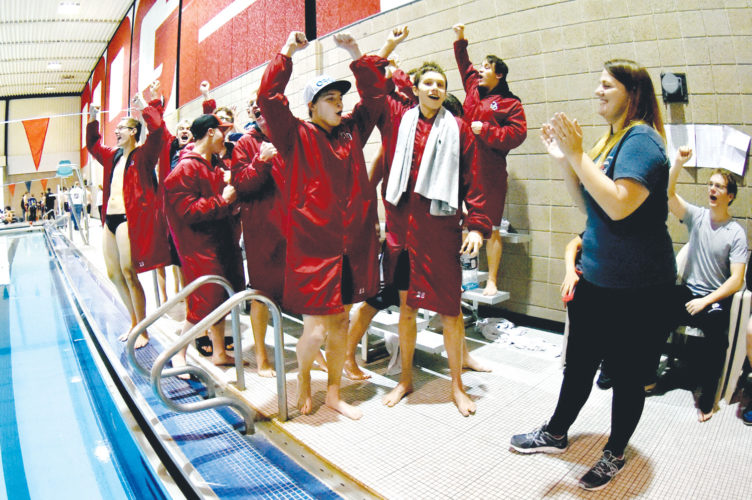 -Messenger Photo by Britt Kudla Fort Dodge Boys Swim Team celebrates after learning of their first place victory during Rusty Garst Invitational on Saturday inside Dodgers Pool