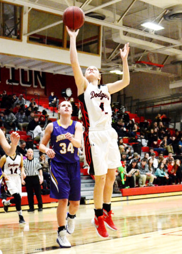 Messenger photo by Britt Kudla  Beth Murman of Fort Dodge shoots against Johnston in the Dodger gym.